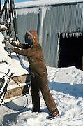 Alaska. A welder checks his equipment in the bitter cold of Alaska.