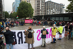London, UK. 14th September, 2021. Quakers form a large circle during a Stop The Arms Fair protest outside ExCeL London on the first day of the DSEI 2021 arms fair. Activists from a range of different groups have been protesting outside the venue for one of the world's largest arms fairs for over a week.