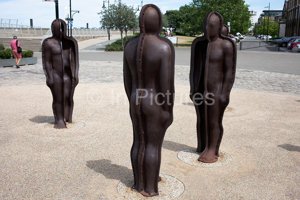 Peter Burkes sculpture called Assembly, consisting of several men made of cast iron at Woolwich Arsenal in London, United Kingdom.