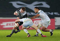 Ospreys' Bradley Davies is tackled by Saracens' Owen Farrell<br /> <br /> Photographer Simon King/Replay Images<br /> <br /> European Rugby Champions Cup Round 5 - Ospreys v Saracens - Saturday 13th January 2018 - Liberty Stadium - Swansea<br /> <br /> World Copyright © Replay Images . All rights reserved. info@replayimages.co.uk - http://replayimages.co.uk