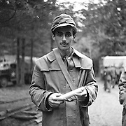 Concentration camp inmate -- Gunskirchen Lager camp, liberated by the 71st Division, who spoke English, was place in charge when the Americans came. Notice faint yellow star of David over his heart.