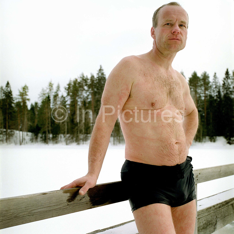 A portrait of a man after ice swimming at Luonetjarvi lake, Tikkakoski; Central Finland. Ice swimming takes place in a body of water with a frozen crust of ice, which requires a hole cutting in it.  In Finland, the ice swimming tradition has generally been connected with the sauna tradition and it is not seen as an ascetic or religious ritual, but as a way to cool off rapidly after staying in the sauna and as a stress relief.