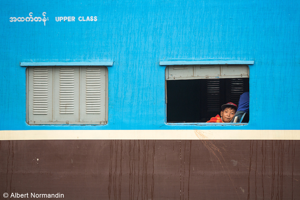 Young boy getting comfortable in Upper Class train car, Aung Ban