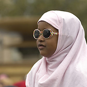 Young muslim girl wearing hijab and sunglasses, Eid in the Square, London, England<br />