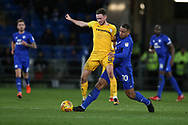 Alan Browne of Preston North End (l) is tackled by Kenneth Zohore of Cardiff city.EFL Skybet championship match, Cardiff city v Preston North End at the Cardiff city stadium in Cardiff, South Wales on Friday 29th December 2017.<br /> pic by Andrew Orchard, Andrew Orchard sports photography.