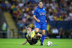 Jonny Giles of Oxford United sliding tackle on Matthew James of Leicester City - Mandatory byline: Jason Brown/JMP - 19/07/2016 - FOOTBALL - Oxford, Kassam Stadium - Oxford United v Leicester City - Pre Season Friendly