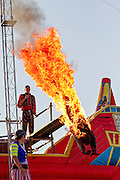 """A burning stunt man dives into water during the """"Pirate Ship"""" children's play at the 2011 Kentucky state fair. Kentucky, USA"""
