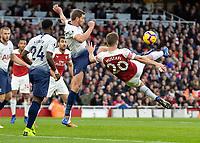 Football - 2018 / 2019 Premier League - Arsenal vs. Tottenham Hotspur<br /> <br /> Jan Vertonghen (Tottenham FC)  blocks the acrobatic attempt at goal from Shkodran Mustafi (Arsenal FC) at The Emirates.<br /> <br /> COLORSPORT/DANIEL BEARHAM