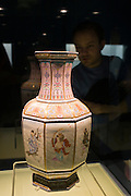 Visitor looks at Ming vase on display in the Shanghai Museum, China