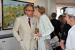 The EARL OF MARCH and COURTNEY LOVE at the 3rd day of the 2011 Glorious Goodwood Racing Festival - Ladies Day at Goodwood Racecourse, West Sussex on 28th July 2011.