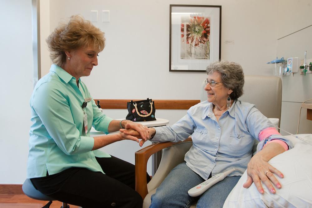 Weymouth, MA 06/20/2011.Volunteer Lisa Battista gives a hand massage to patient Janet Stover..Alex Jones / www.alexjonesphoto.com