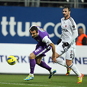 Besiktas's Hugo Almedia (R) and Orduspor's Yalcin Ayhan (L) during their Turkish superleague soccer match Besiktas between Orduspor at Mardan Stadium in Antalya Turkey on Monday, 05 December 2011. Photo by TURKPIX
