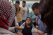 Grief stricken, a lady faints in a Red Crescent tent at Somas' cemetery, as medical staff tend to her. An electrical fault caused an explosion in the shaft resulting in at least 282 workers being killed in the disaster. Soma, Western Turkey.