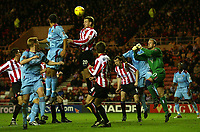 Fotball<br /> England 2004/2005<br /> Foto: SBI/Digitalsport<br /> NORWAY ONLY<br /> <br /> Sunderland v West Ham United<br /> Coca-Cola Championship, Stadium of Light, Sunderland 04/12/2004.<br /> <br /> Sunderland's goalkeeper, Thomas Myhre (R), looks to punch clear as his team-mate Chris Brown (#20) rises to head the ball.