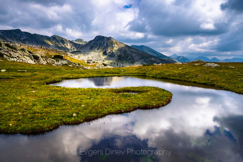 Reflections of clouds in a mountain lake