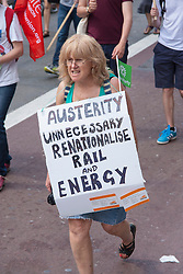 London, June 21st 2014. A woman demands the renationalisation of the rail network and energy supples as thousands protest against austerity in London.