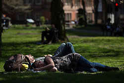© Licensed to London News Pictures . 21/04/2015 . Manchester , UK . Sunbathers in Manchester's Sackville Park , this afternoon (Tuesday 21st April 2015) . Photo credit : Joel Goodman/LNP
