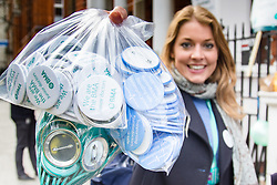 Great Ormond Street Hospital, London, April 26th 2016. A woman holds to bags of badges with messages supporting the strike as junior doctors picket outside Great Ormond Street Hospital for Children.