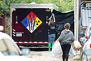 Hazmat workers put up a tarp in an alley behind the apartment where a second Ebola patient has been reported in Dallas, Texas on October 12, 2014. (Cooper Neill for The New York Times)
