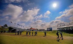 Crowds cross the 18th fairway infront of the clubhouse during day three of the Betfred British Masters at Hillside Golf Club, Southport.