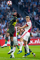 14-08-2018 NED: Champions League AFC Ajax - Standard de Liege, Amsterdam<br /> Third Qualifying Round,  3-0 victory Ajax during the UEFA Champions League match between Ajax v Standard Luik at the Johan Cruijff Arena / Matthijs de Ligt #4 of Ajax, Arnaud Bodart #16 of Standard Liege