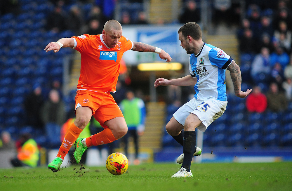 Blackpool's Jamie O'Hara vies for possession with Blackburn Rovers' Jay Spearing<br /> <br /> Photographer Chris Vaughan/CameraSport<br /> <br /> Football - The Football League Sky Bet Championship - Blackburn Rovers v Blackpool - Saturday 21st February 2015 - Ewood Park - Blackburn<br /> <br /> © CameraSport - 43 Linden Ave. Countesthorpe. Leicester. England. LE8 5PG - Tel: +44 (0) 116 277 4147 - admin@camerasport.com - www.camerasport.com