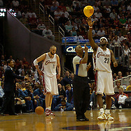 PHOTO BY DAVID RICHARD.LeBron James of Cleveland gives a taller hand to NBA official Marc Davis after the ref failed to reach a balloon floating over the court at Quicken Loans Arena