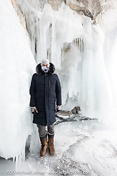 Russian custom bike builder Yaroslav Tatarinov in an ice cave on an island in the middle of Lake Baikal after the Baikal Mile Ice Speed Festival. Maksimiha, Siberia, Russia. Sunday, March 1, 2020. Photography ©2020 Michael Lichter.