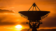 Radio telescope at sunset, Very Large Array (VLA), Plains of San Agustin, Socorro, New Mexico USA