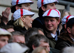 File photo dated 26/02/11 of Zara Phillips and Prince Harry during the RBS 6 Nations match at Twickenham, London. The Duchess of Sussex looks set to have turned to her inner circle of faithful friends for son Archie's godparents.