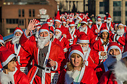 The race starts in front of St Paul's cathedral and heads straight over the Millennium bridge - Thosuands of runners, of all ages, in santa suits and other Christmas costumes run through the City of London for charity and for fun. London 30 Nov 2016