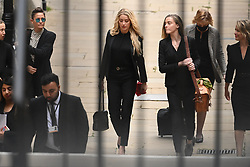 © Licensed to London News Pictures. 16/07/2020. London, UK. American actress AMBER HEARD arrives at the High Court in London where Johnny Depp is in a legal dispute with UK tabloid newspaper The Sun over allegations he assaulted his former wife, Amber Heard. Photo credit: Ben Cawthra/LNP