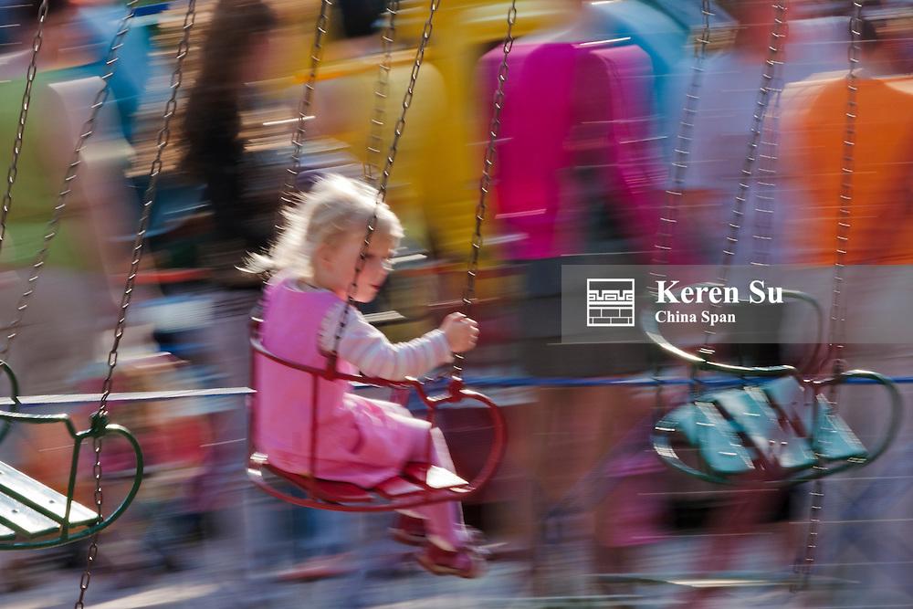 Children playing in swing, Vitebsk, Belarus