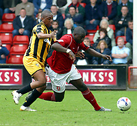 Photo: Dave Linney.<br />Walsall v Port Vale. Coca Cola League 1. 15/04/2006.<br />Walsall's Pablo Mills(R) batteles with Leon Constantine