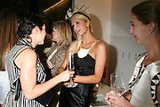Paris Hilton (center) talks to Step Up Women's Network members