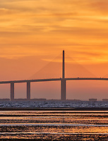 Sun rising under the Sunshine Skyway bridge from Fort De Soto Park. Print copy 3 of 5 images taken with a Fuji X-H1 camera and 200 mm f/2 OIS lens with a 1.4x teleconverter (ISO 400, 280 mm, f/16, 1/80 sec). Raw images processed with Capture One Pro and AutoPano Giga Pro.