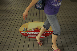 June 25, 2017 - Hong Kong, CHINA - Woman walk past a seal on the ground that depict celebration of 20th anniversary of Hong Kongs HANDOVER. June 25, 2017.Hong Kong. ZUMA/Liau Chung Ren (Credit Image: © Liau Chung Ren via ZUMA Wire)