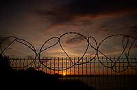 Razor Wire Coiled Fence at Sunset. Walkabout in Westerplatte Memorial Park. Image taken with a Leica X2 camera and 24 mm lens.