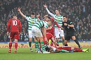 Players call for medics after Dedryck Boyata and Gary Mackay-Steven collide during the Betfred Cup Final between Celtic and Aberdeen at Hampden Park, Glasgow, United Kingdom on 2 December 2018.