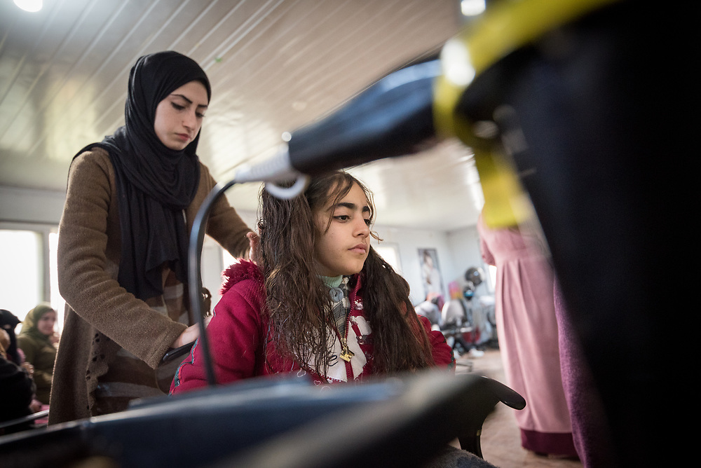 20 February 2020, Za'atari Camp, Jordan: Young girl Tasheem acts as model during hairdressing class in the Peace Oasis, a Lutheran World Federation space in the Za'atari Camp where Syrian refugees are offered a variety of activities on psychosocial support, including counselling, life skills trainings and other activities.