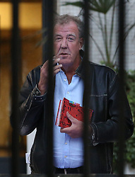 © Licensed to London News Pictures. 01/10/2015. London, UK. Former Top Gear presenter JEREMY CLARKSON takes a cigarette break before recording the first episode of the new series of Have I Got News for You Photo credit: Peter Macdiarmid/LNP