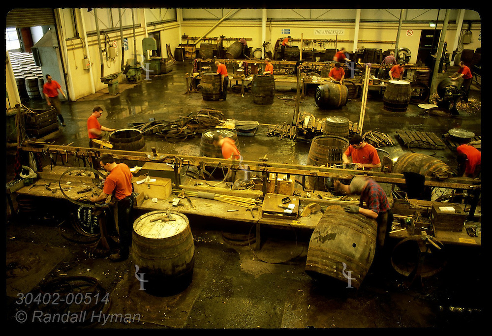 Coopers hammer, shave, fit & assemble old casks for whisky making at Speyside Cooperage; Dufftown. Scotland