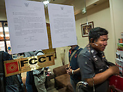 """26 JUNE 2015 - BANGKOK, THAILAND: Thai Police Colonel KITTIGORN BOONSOM, walks out of the Foreign Correspondents' Club of Thailand (FCCT) after cancelling a scheduled announcement by Human Rights Watch (HRW) about human rights in Vietnam. HRW was scheduled to launch a new report, """"Persecuting 'Evil Way' Religion: Abuses against Montagnards in Vietnam"""", at the FCCT in Bangkok Friday morning. The report made no mention of the human rights situation in Thailand. The Thai Ministry of Foreign Affairs (MFA) contacted HRW Thursday afternoon and asked them to cancel the program because it was a """"sensitive"""" matter that could impact on Thai-Vietnam relations. HRW told the MFA that they would go ahead with the report's release. Friday morning, before the report was scheduled to be released, Thai police officers arrived at the FCCT and cancelled the event. Phil Robertson, deputy director of Human Rights Watch's Asia division, said, """"By stepping in to defend a neighboring state's human rights violations against a group of its people and interrupting a scheduled press conference, Thailand's military junta is violating freedom of assembly and demonstrating its contempt for freedom of the press.""""       PHOTO BY JACK KURTZ"""