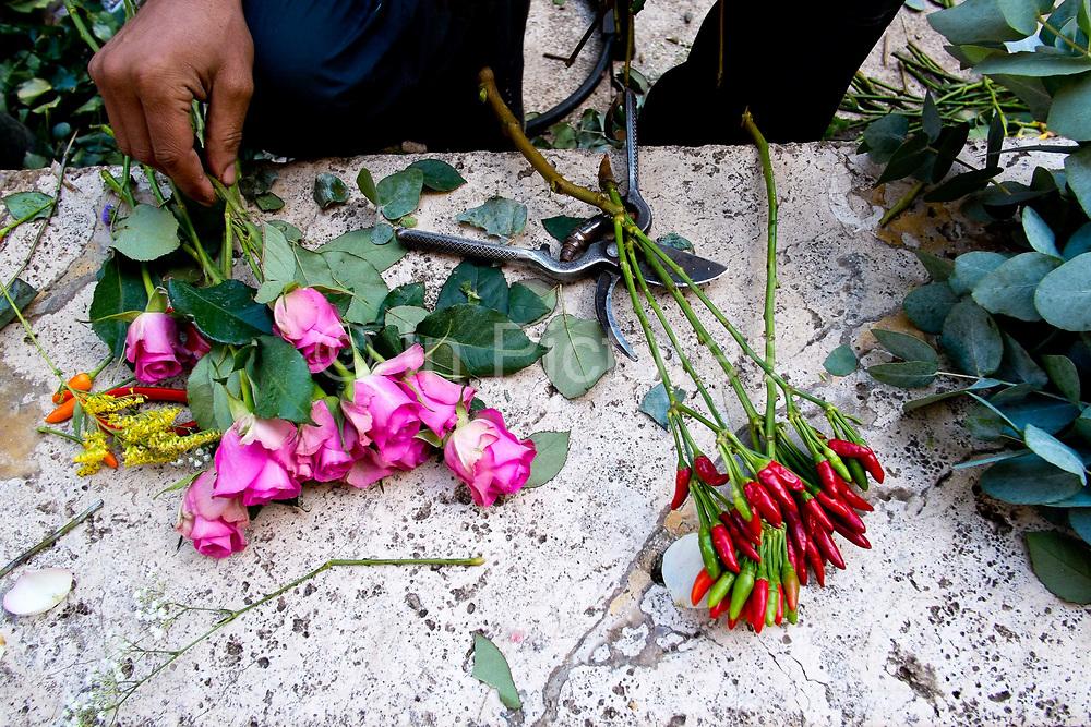 Flower arrangers hands detail shot, Rome, Italy.