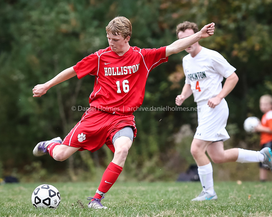 (10/21/15, HOPKINTON, MA) Holliston's Cam Waddell takes a shot that is deflected with Hopkinton pressuring during the boys soccer game at Hopkinton High School on Wednesday. Daily News and Wicked Local Photo/Dan Holmes