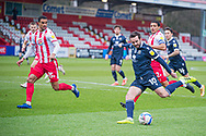 Morecambe midfielder Aaron Wildig (10) has a shot as it is saved by Stevenage goalkeeper David Stockdale (37) during the EFL Sky Bet League 2 match between Stevenage and Morecambe at the Lamex Stadium, Stevenage, England on 6 February 2021.