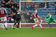 Barnsley forward Mamadou Thiam (26) has a shot at goal but goes wide during the The FA Cup 3rd round match between Burnley and Barnsley at Turf Moor, Burnley, England on 5 January 2019.