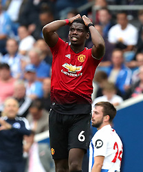 Manchester United's Paul Pogba reacts during the Premier League match at the AMEX Stadium, Brighton.