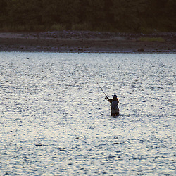 A woman fishing in Casco Bay near Martin Point in Portland, Maine.