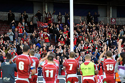Scarlets supporters in the crowd celebrate their team's win at the final whistle - Photo mandatory by-line: Patrick Khachfe/JMP - Tel: Mobile: 07966 386802 12/10/2013 - SPORT - RUGBY UNION - Twickenham Stoop - London - Harlequins V Scarlets - Heineken Cup